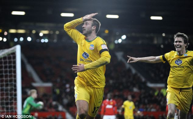 Heading for victory: Murray played his part in Palace's League Cup win over Manchester United last season