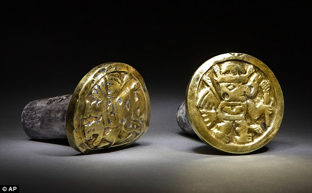 Treasures: A pair of gold-and-silver ear ornaments found alongside what archaeologists believe were three Queens of the ancient and mysterious Wari civilisation