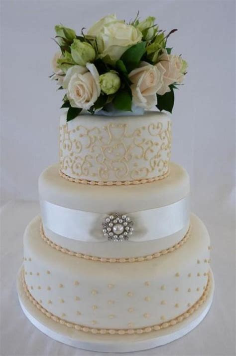 Wedding Cake With Filigree, Pearls And Pastel Gold