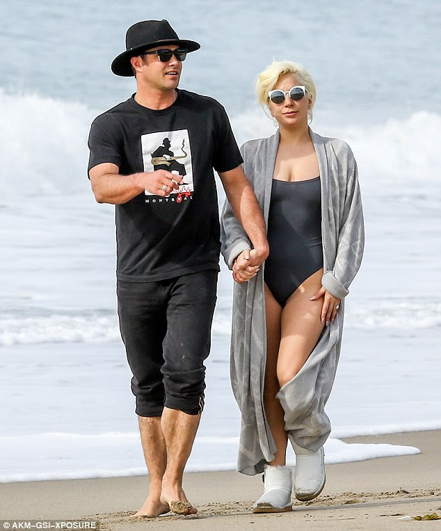 Shady lady: Lady Gaga shielded her eyes with a pair of white edged round lens sunglasses which perfectly complimented her look