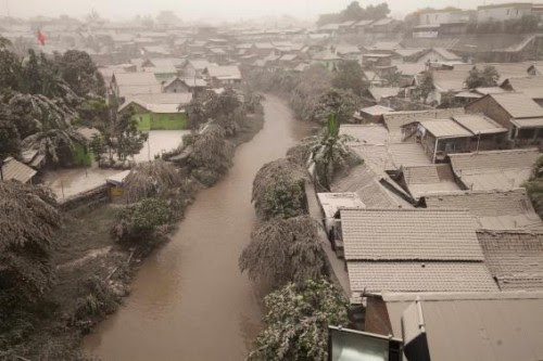 A housing complex is seen covered with ash from Mount Kelud, in Yogyakarta
