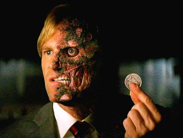 Harvey Dent, now Two-Face, in the climactic scene of THE DARK KNIGHT.