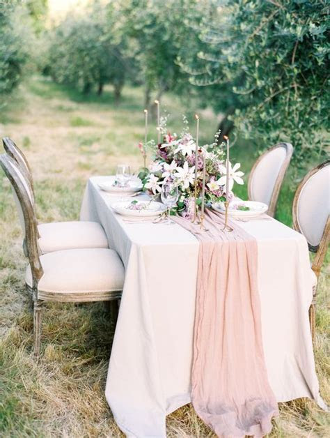 Picture Of a blush silk table runner and matching candles