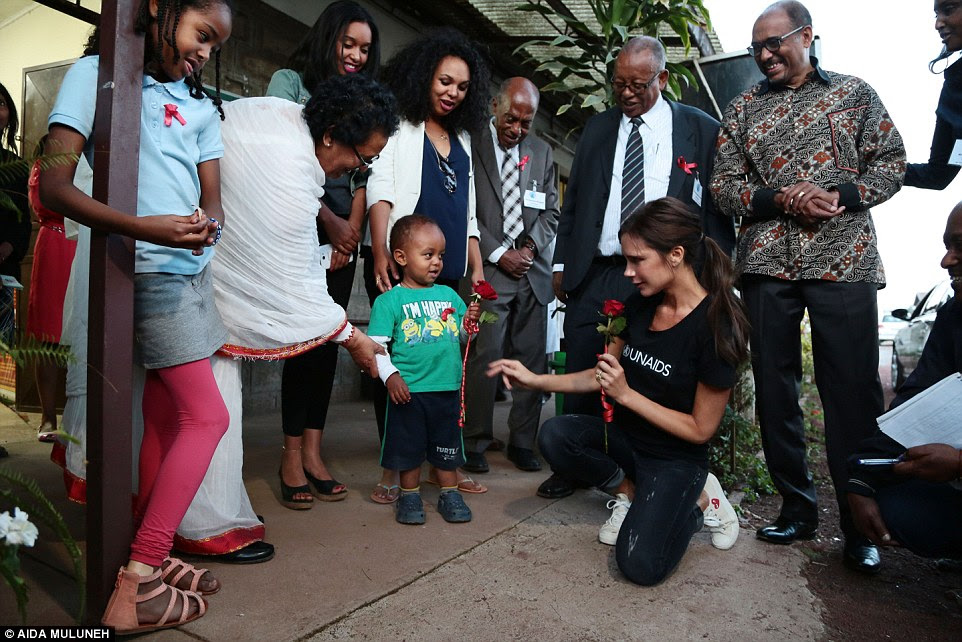 During a recent field mission to Ethiopia with the Executive Director of UNAIDS, Michel Sidibé, mother-of-four Victoria met with a number of children, adolescents and adults living with and affected by HIV and AIDS. In this snap, which the fashion designer shared to mark World AIDS Day on Tuesday, she is seen receiving a red rose from a young boy