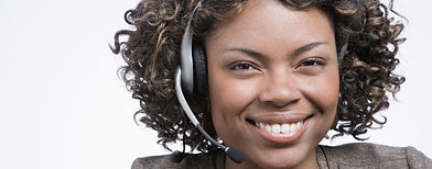 Woman with headset (Thinkstock)