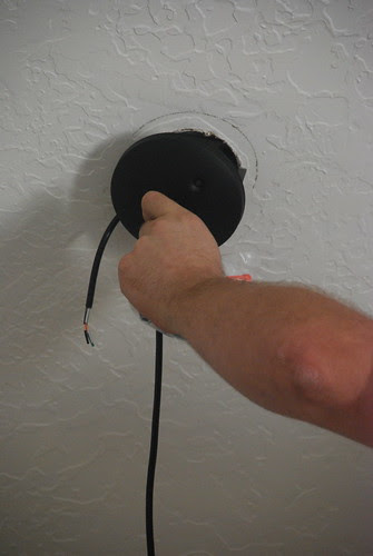 securing the new light fixture