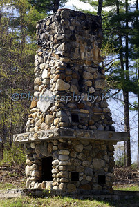 a fireplace constructed of stones