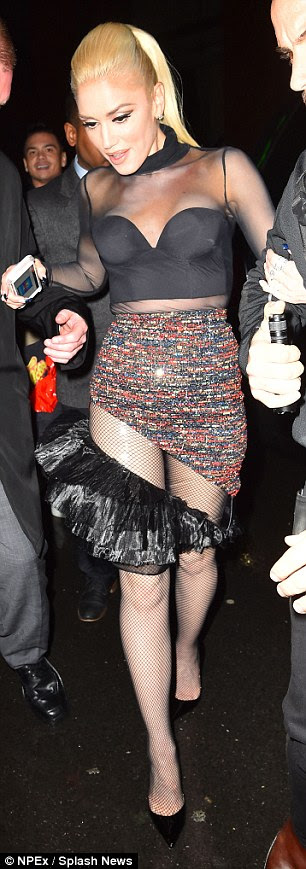 Skimpy: The sideways cut of the dress made for a skimpy show from behind as her fabulous derriere was on display