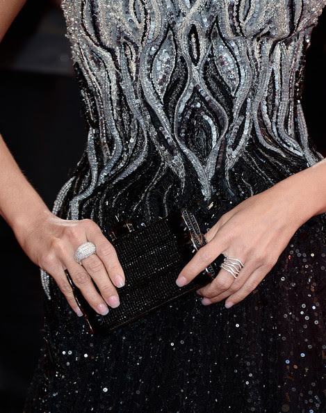 Actress Kristin Chenoweth (ring and clutch detail) arrives at the Oscars at Hollywood & Highland Center on February 24, 2013 in Hollywood, California.