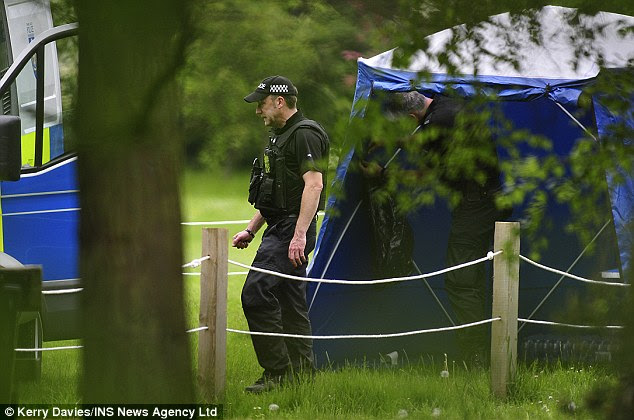 Armed police erected a blue tent near the edge of park in Oxford as the search continued for Allen