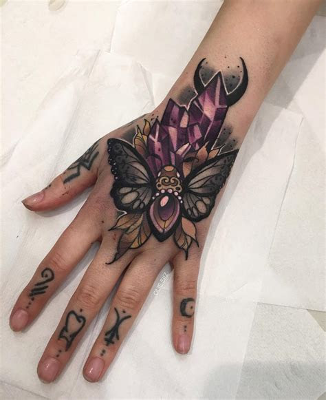 moth crystals girls hand tattoo tattoo design ideas