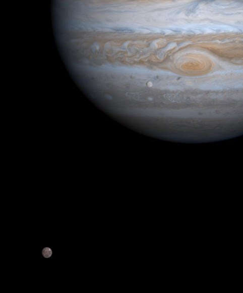 Europa (bottom left) in orbit around its planet, Jupiter, as spotted from the Cassini spacecraft in 2000. Credit: NASA/JPL/University of Arizona
