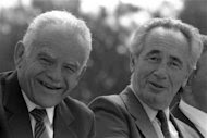 Israel's Prime Minister Yitzhak Shamir (L) and Foreign Minister Shimon Peres attend the traditional Mimouna celebrations in Jerusalem March 15, 1988 in this handout photo released by the Israeli Government Press Office (GPO). REUTERS/Nati Harnik/GPO/Handout