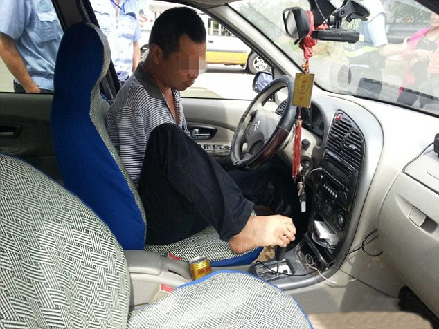 Toe-tally incredible: Wo Guo has driven 100,000 miles using his feet