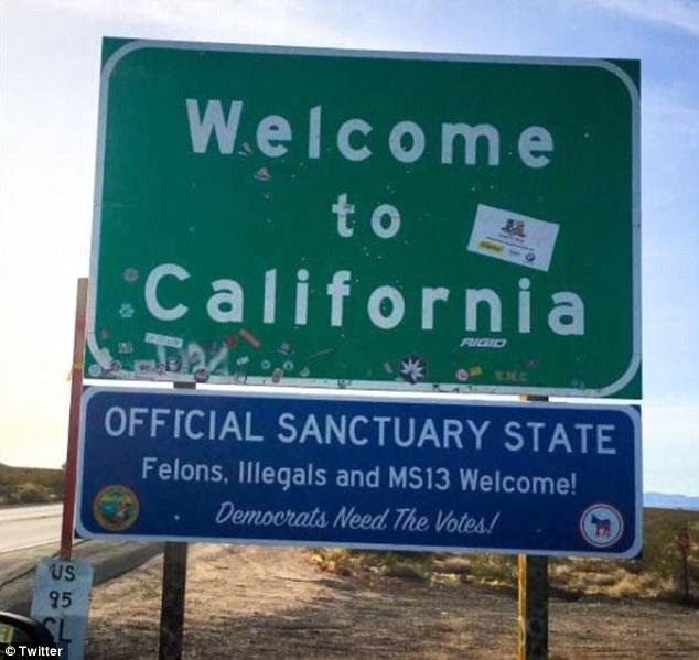 Joke signs were posted on California highways as The Golden State became a sanctuary state on Monday, which read: 'OFFICIAL SANCTUARY STATE, Felons, Illegals and MS13 Welcome! Democrats Need The Votes!'