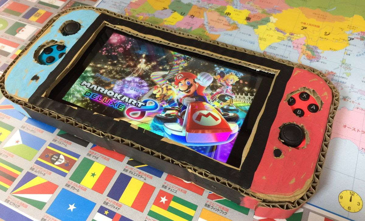Dad replaces son's cardboard Nintendo Switch with real one screenshot