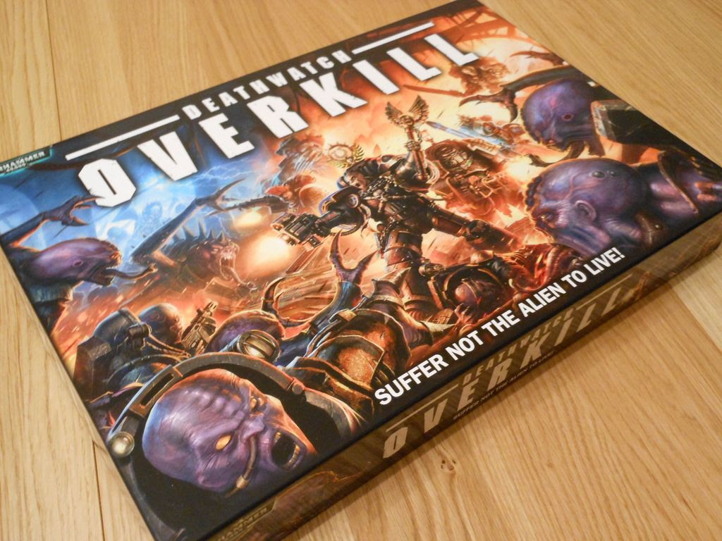 The box for Deathwatch: Overkill, featuring artwork with stoic space marines locked in combat with genestealer hybrids.