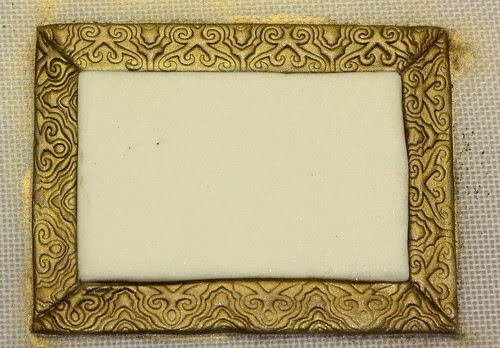 fondant frame with antique gold luster dust