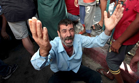 A relative of the four Palestinian children killed by a shell fired by an Israeli naval gunboat.