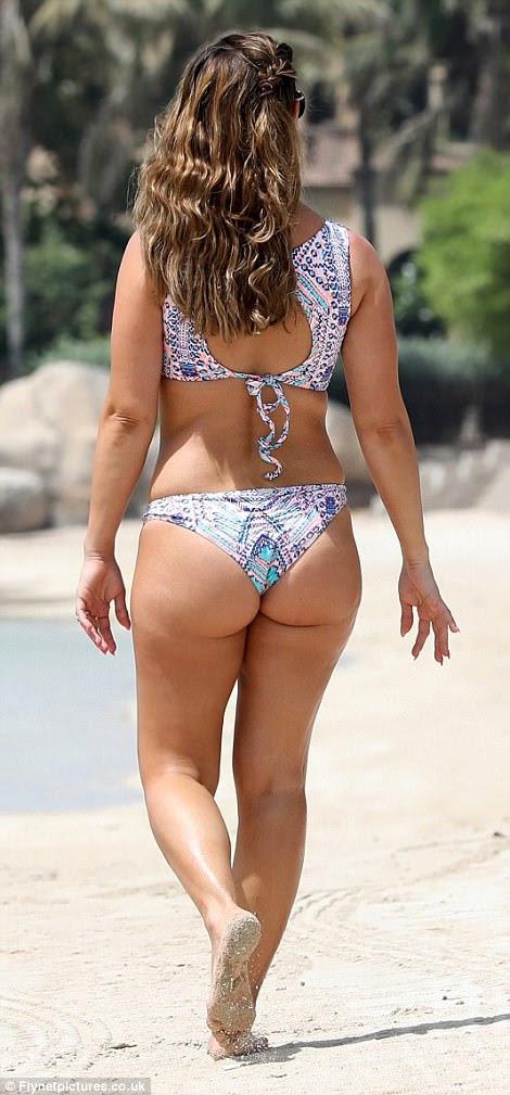 Rebekah Vardy shows off her figure in halterneck bikini