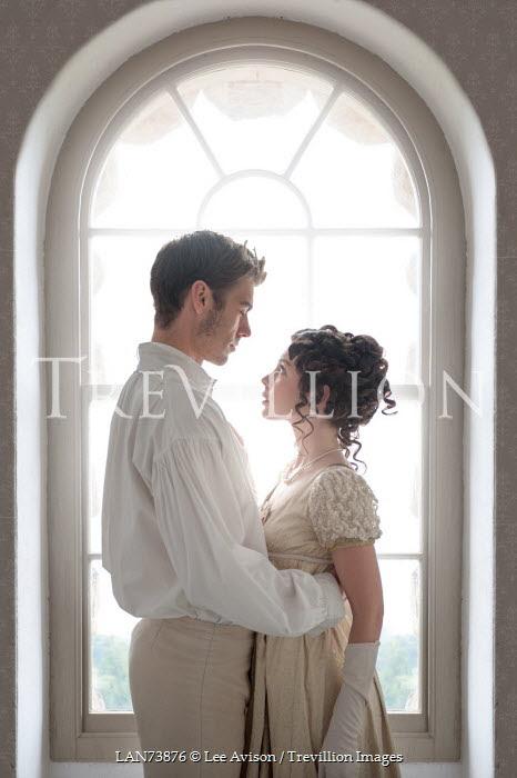 Lee Avison regency couple embracing beneath arched window Couples