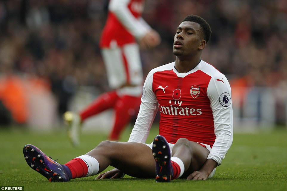 Alex Iwobi reacts after squandering a chance to put his side in the lead during the opening exchanges at the Emirates