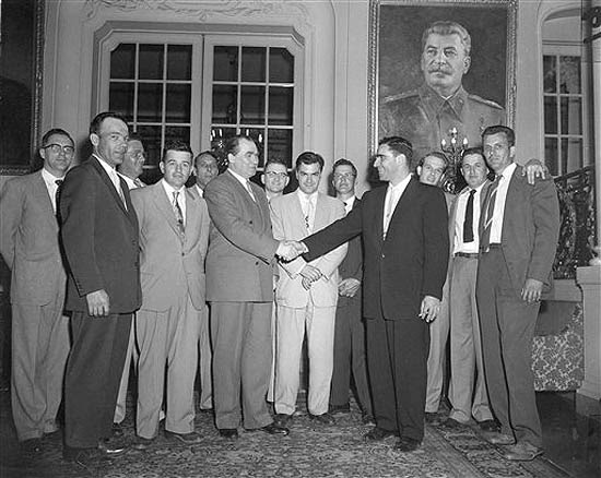 Elbe veterans visit Soviet Ambassador. Soviet Ambassador Georgi Zarubin, left, shakes hands with Murray Schulman of Queens Village, N.Y. as a group of U.S. Army veterans who participated in the Elbe River link-up with Russian troops 10 years ago call on him. April 25, 1955 the Russian Embassy in Washington, D.C. Left to right are: Edwin Jeary, Robert Haag, Byron Shiver, John Adams, Charles Forrester, Zarubin, William Weisel, Yuri Gouk, Soviet second secretary, Elijah Sams, Schulman, Robert Legal, Fred Johnston and Claude Moore (AP Photo/John Rous). Source: AP Images