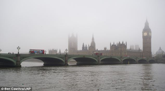 The Houses of Parliament and Big Ben appeared faded in the misty fog this morning