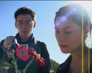 Production Photo 6 - Maya and Wiler Look At Flowers