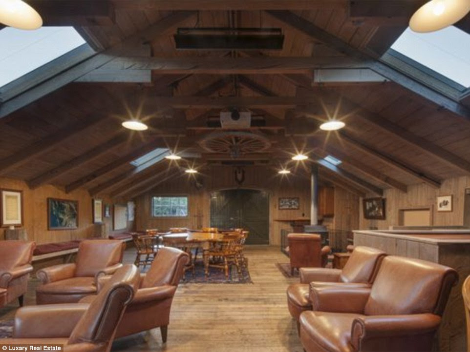 Retreat: This NZ$2,995,000 property, on a farm accessed by a bridge built with old railway sleepers, has 'all the aspects needed to build the ultimate alpine retreat' - yet it is just 10km from Queenstown
