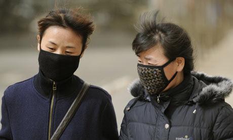 Two women wearing facemasks, China