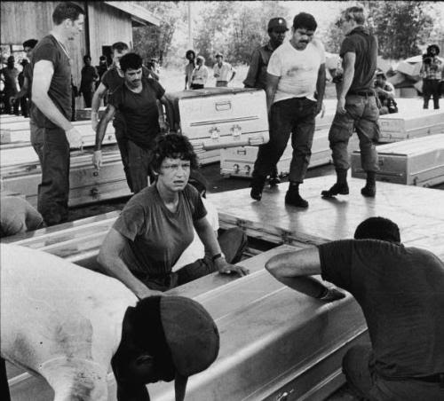 Members of a US military team prepare aluminum coffins for shipment to the United States, following the more than 900 deaths in the mass suicide staged in Jonestown by members of the People's Temple and their leader, the Reverend Jim Jones, Georgetown, Guyana, November 24, 1978.