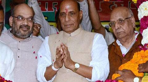 BJP President Rajnath Singh, party's UP incharge Amit Shah (left) and Lalji Tandon being garlanded at a programme in Lucknow on Thursday. (PTI Photo)
