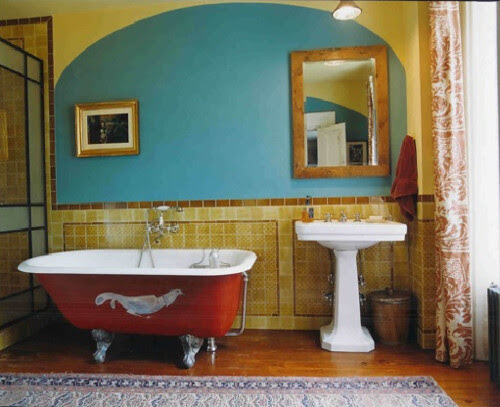 Colorful bathroom with awesome clawfoot tub.