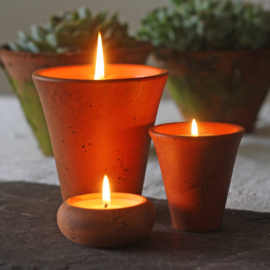 scented candles in flower pots by the wedding of my dreams ...