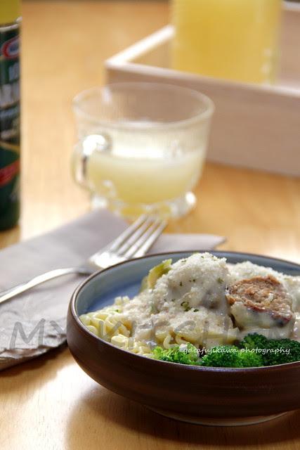 Pasta with meatball and cream mushroom sauce