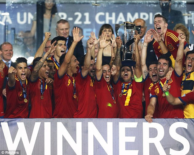 Champions: The Spanish U21 stars are jubiliant as they celebrate by lifting the trophy after their 4-2 win