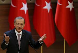 Turkish President Erdogan makes a speech during his meeting with mukhtars at the Presidential Palace in Ankara, Turkey