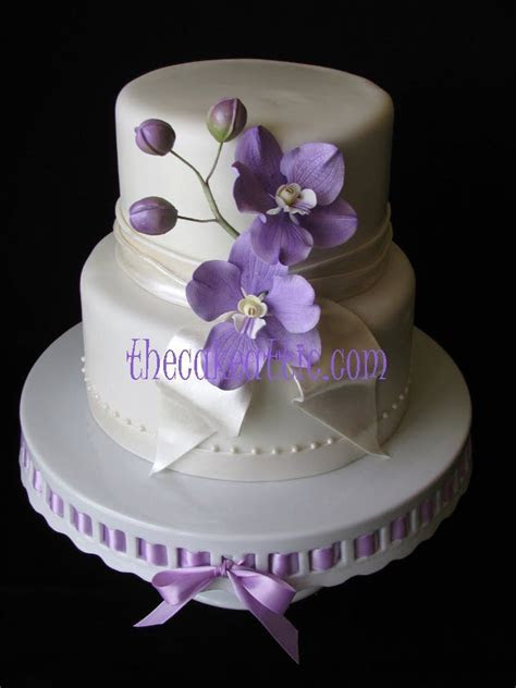 Fondant covered wedding cake with lilac sugar orchids by