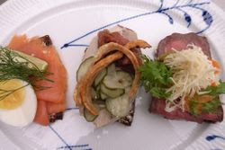 For a hearty and traditional Danish lunch, try out the delicious Smørrebrød open-faced sandwiches