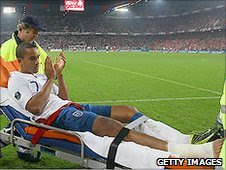 Theo Walcott is stretchered off during England's 3-1 win over Switzerland