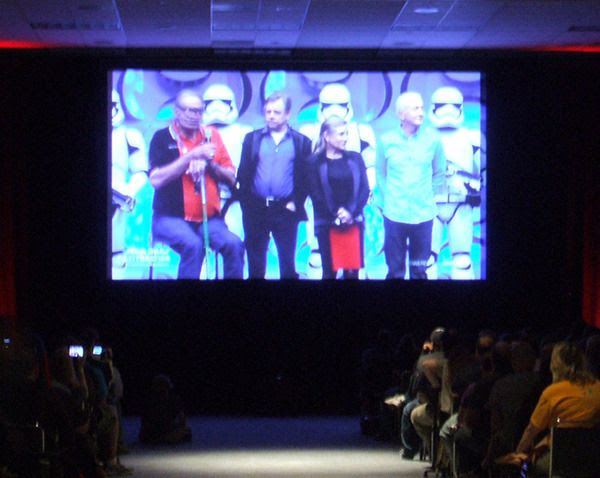 Original Trilogy actors Peter Mayhew, Mark Hamill, Carrie Fisher and Anthony Daniels are flanked by Stormtroopers from THE FORCE AWAKENS at the Star Wars Celebration in Anaheim, California...on April 16, 2015.