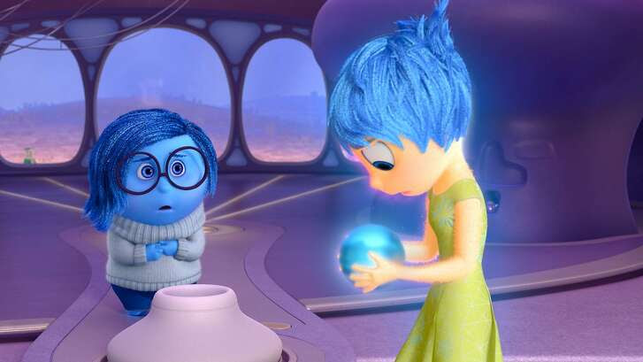 "In the Disney-Pixar summer release ""Inside Out,"" about the voices inside an 11-year-old girl's head, little blue Sadness is voiced by Phyllis Smith (""The Office"") and the much brighter Joy is voiced by Amy Poehler (""Parks and Recreation""). The movie opens Friday, June 19. Pictured (L-R): Sadness, Joy. ©2015 Disney•Pixar. All Rights Reserved."