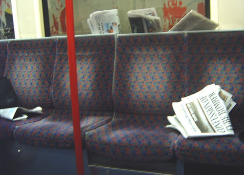 Discarded papers in Tube Carriage