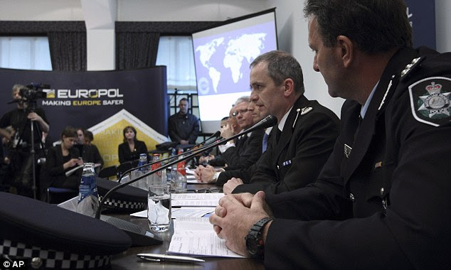 Announcement: Grant Edwards, Australian Federal Police, left, and Peter Davies, of the UK Child Exploitation and Online Protection Centre reveal details of the huge global police operation that tracked 670 suspects and led to 120 arrests in Britain