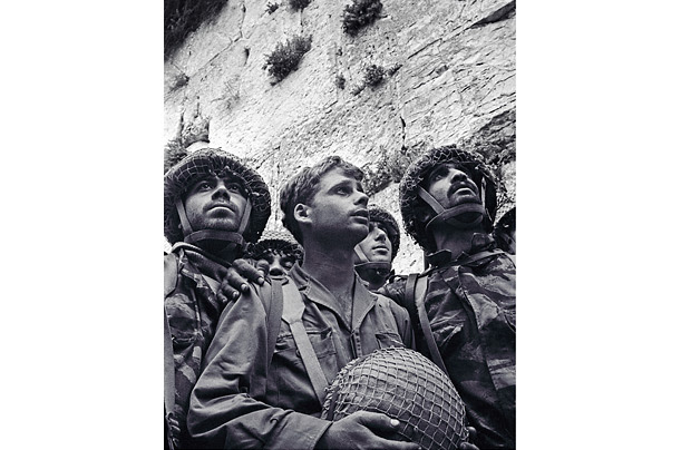 June 7, 1967: Three paratroopers minutes after taking he Western Wall, Jerusalem, during the Six Day War