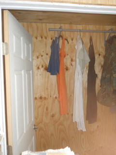 Dresses Hanging in the Bedroom Closet