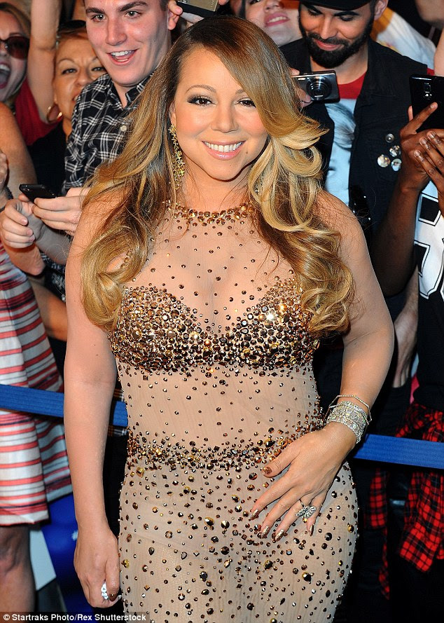 Nude awakening! Mariah Carrey makes her official arrival in Las Vegas ahead of residency ...and flashes underwear in see-through bejewelled outfit on Monday