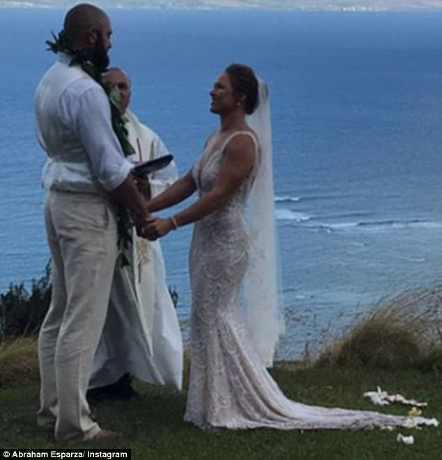 Newlyweds: Ronda Rousey and Travis Browne tied the knot on Saturday during a ceremony in Hawaii, Travis' native state, in what appears to have been a joy-filled day