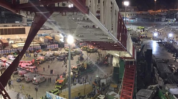 Strong wind and rains reportedly uprooted trees and rocked cranes in the area around the Grand Mosque [AP]